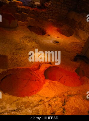 Recessed vessels used for honey and sea salt, in a wine making facility, in the Roman city, Barcelona, Spain.4th - Stock Photo