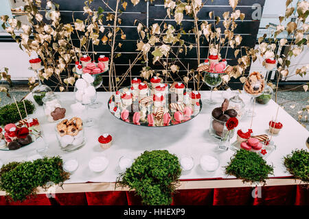 Dessert Sweet Tasty Cupcakes And Cookies In Candy Bar On Table. Delicious Sweet Buffet. Wedding Decorations - Stock Photo