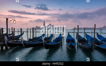 Pre-dawn light over gondolas and San Giorgio Maggiore, Venice, Veneto, Italy - Stock Photo