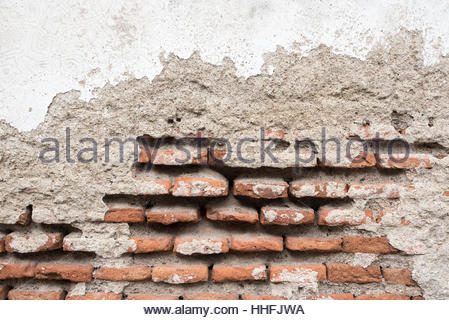 Weathered and worn out brick walls. Cuba colonial architecture is a tourist attraction in the tropical Caribbean - Stock Photo