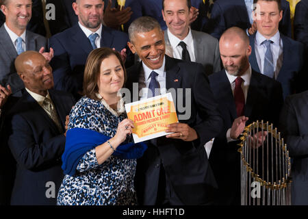 US President Barack Obama (Front R) is presented a pass to Wrigley Field by Chicago Cubs co-owner Laura Ricketts - Stock Photo