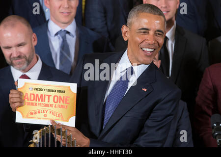 US President Barack Obama holds a pass to Wrigley Field presented to him during an event held to welcome the Chicago - Stock Photo
