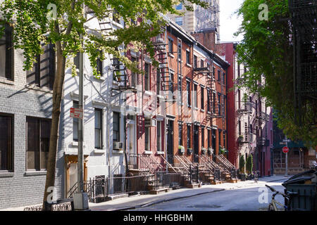 Sunshine on the trees, sidewalks, and historic buildings of Gay Street in the Greenwich Village neighborhood of - Stock Photo