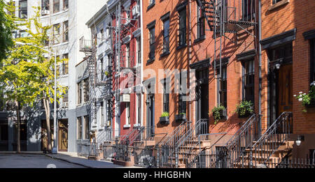 Panoramic view of colorful row of old buildings along Gay Street in the Greenwich Village neighborhood of Manhattan, - Stock Photo