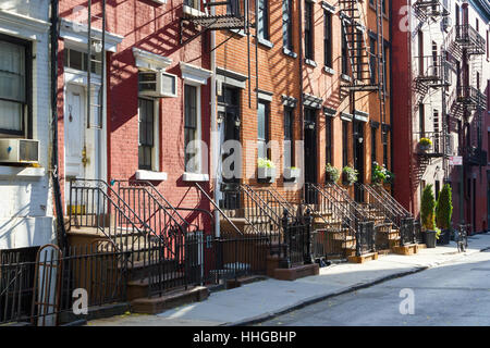 Sunlight shines on a block of historic apartment buildings on Gay Street in the Greenwich Village neighborhood of - Stock Photo