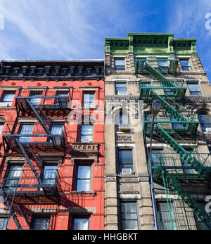 Colorful old vintage apartment buildings with fire escapes in the Greenwich Village neighborhood of Manhattan in - Stock Photo