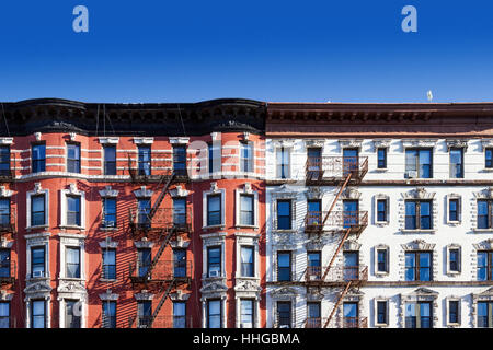 New York City block of old historic apartment buildings in the East Village of Manhattan, NYC with a clear blue - Stock Photo