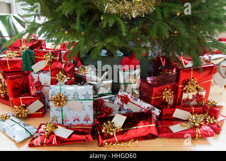 picturesque view of a decorated christmas tree with xmas presents beautifully wrapped under the tree - Xmas Presents
