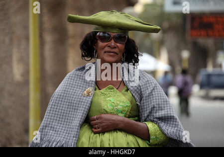 Herero woman at Swakopmund in Namibia - Stock Photo