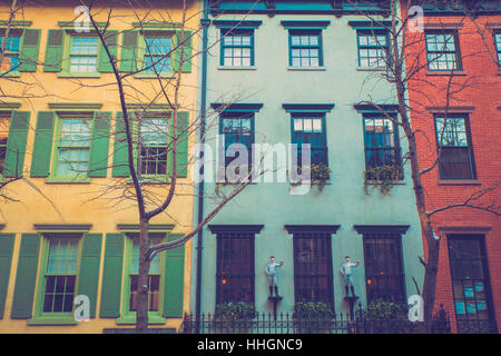 Charming row of colorful apartment building homes on quaint street in New York City with retro filter effect. - Stock Photo