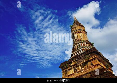 An ancient pagoda against blue sky in Sukhothai historical park, one of the UNESCO cultural World heritage site - Stock Photo