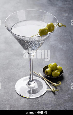 Martini cocktail on dark stone table - Stock Photo