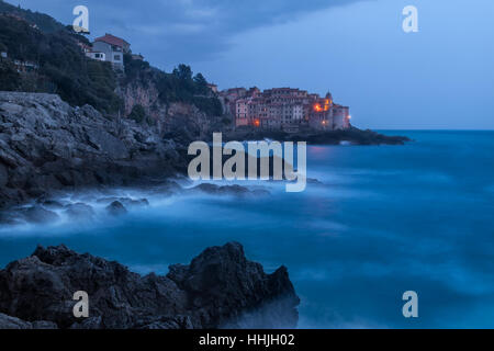 Tellaro at blue hour in a windy night - Stock Photo