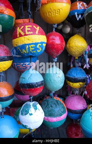 Key West words on colorful buoys. - Stock Photo