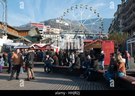 Christmas Market with ferris wheel in Montreux, Switzerland - Stock Photo