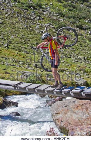 bridge, biker, torrent, mountainbiker, bridge, austrians, biker, meadows, - Stock Photo