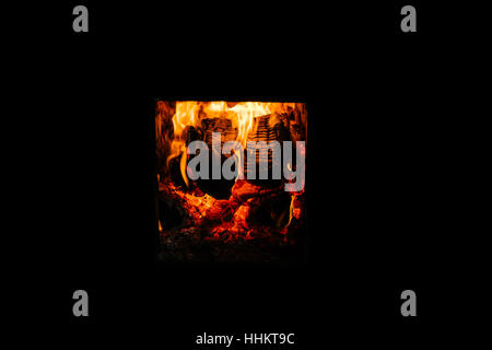 Russian fire in the stove. Open the oven door . It is seen as the burning firewood. - Stock Photo