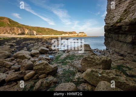 Rocky cliffs at Thornwick bay near Flamborough, North Yorkshire, England. - Stock Photo