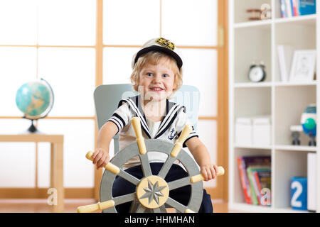 Child boy in sailor hat - adventure and travel concept. - Stock Photo