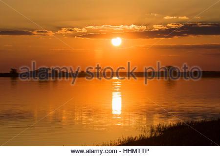 Sunset at the water, Nata Bird Sanctuary, Botswana - Stock Photo