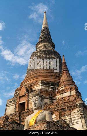 Buddha statue in front of large Chedi, Wat Yai Chai Mongkhon, Ayutthaya Historical Park, Thailand - Stock Photo