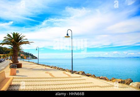 Promenade seafront or esplanade in Porto Santo Stefano harbor, Monte Argentario, Tuscany, Italy. - Stock Photo