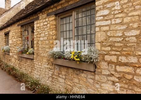 Castle Combe, Wiltshire, England - July 13, 2016: Main street in beautiful old English village. Castle Combe is - Stock Photo