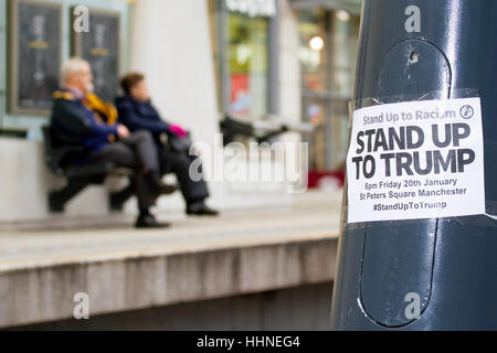 'Stand Up to Trump' planned demonstration poster on lamppost in Manchester, UK - Stock Photo