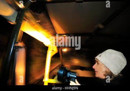 Woman with a  powerful torchlight  searching for wild animals   from a landrover on  a safari in iSimangaliso Wetland - Stock Photo