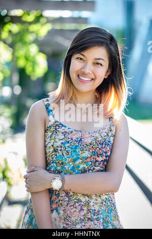 Portrait of smiling Chinese woman wearing dress