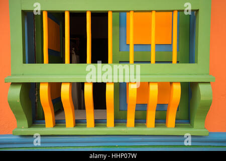 closeup details of a wooden colourful painted window security grate in colombia - Stock Photo