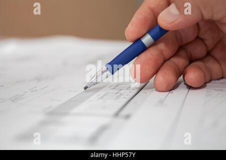 engineer draws pencil selective focus - Stock Photo