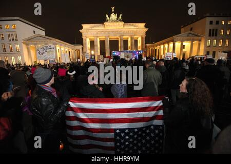 Berlin, Germany. 20th Jan, 2017. Protestors turn the American Flag upside down, a signal of dire distress or extreme - Stock Photo