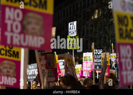London, UK. 20th January 2017. Hundreds of people gather outside the American embassy in Grosvenor Square to protest - Stock Photo