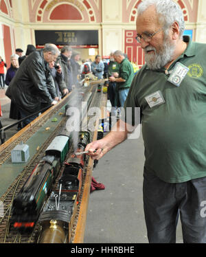 London, UK. 20th Jan, 2017. A member of the Gauge One Model Railway Association display team releasing steam from - Stock Photo