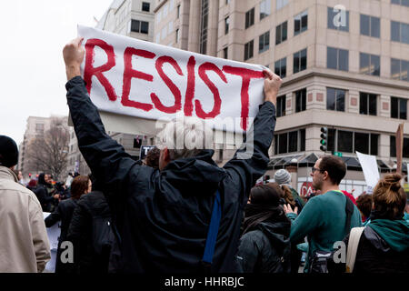 Washington, USA. 20th January, 2017.  Thousands of anti-Trump protesters march just outside of the presidential - Stock Photo