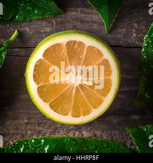 Lemon on wooden background - Stock Photo