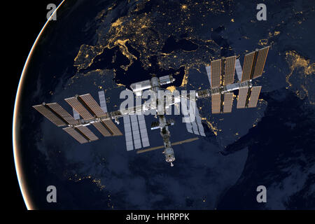 International Space Station over Europe. Elements of this image furnished by NASA. - Stock Photo