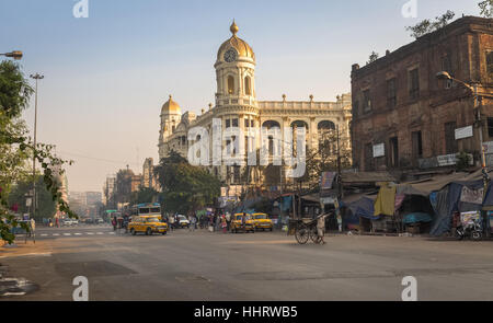 Indian city road at Esplanade Dharmatala an important landmark with a mix of colonial heritage buildings and architecture. - Stock Photo