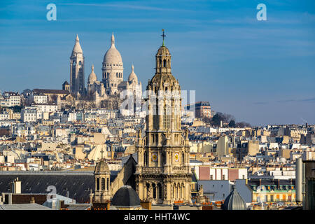 Rooftops of Paris with view of the Sacre Coeur Basilica in Montmartre and the Trinity Church. 18th Arrondissement, - Stock Photo