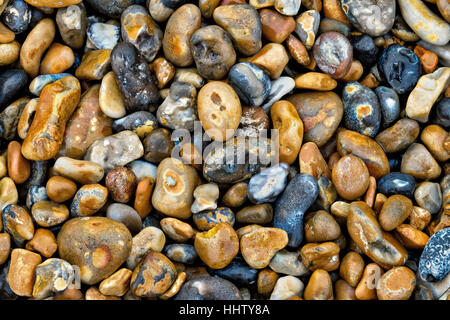 Picture of a pile of peebles on the ground on the beach - Stock Photo