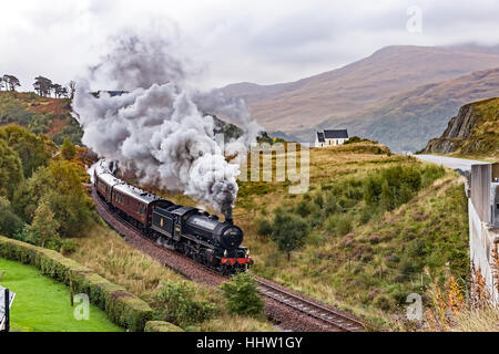 K1 steam engine No. 62034 pulls the Jacobite past the famous church at Polnish en route to Mallaig in Scotland - Stock Photo