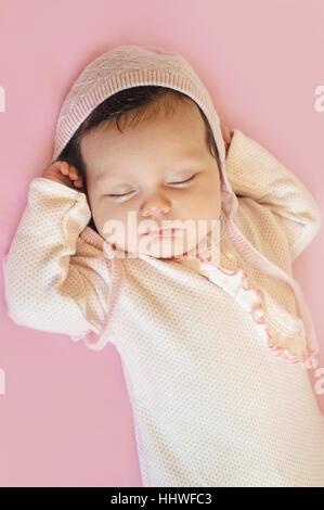 Newborn sweet cute baby girl face sleep - Stock Photo