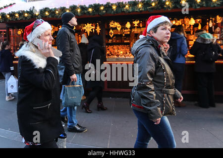 Members of the public enjoy the stalls and bars at Leicester Square Christmas market. After the events in Berlin - Stock Photo