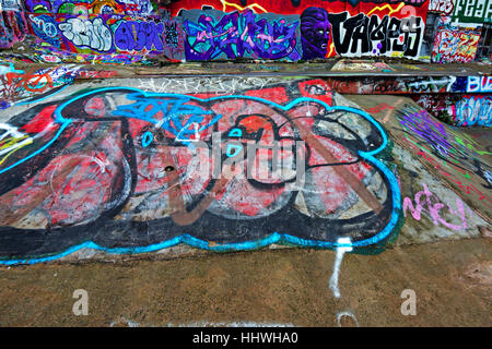 Amazing colorful graffiti in a disused skateboard park in the Baltic Triangle area of Liverpool UK - Stock Photo