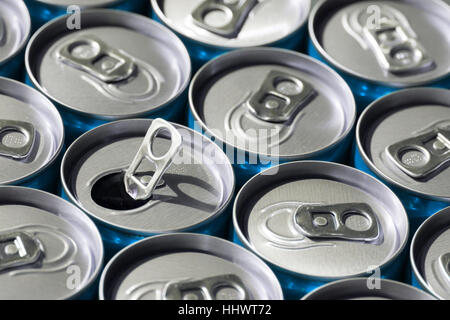 Red soda cans, top view, with one opened - Stock Photo