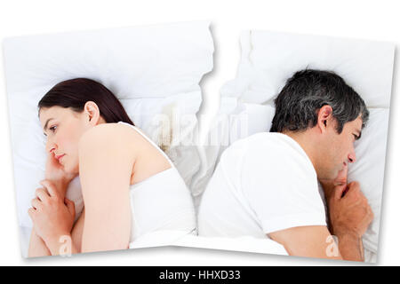 Couple after fighting turned away from each other in bed - Stock Photo