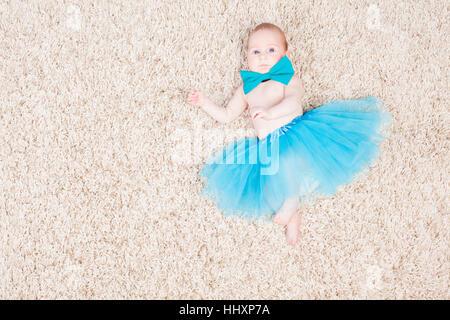 little girl ballerina in blue skirt - Stock Photo