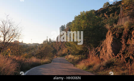 Hilly windy country lane in Alora countryside, Andalusia - Stock Photo