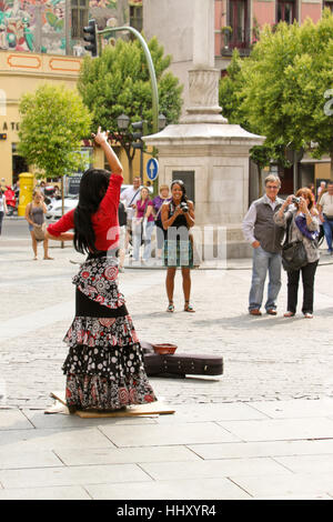MADRID, SPAIN - MAY 21, 2011: Tourists taking pictures of a girl dancing flamenco on the street of Madrid. - Stock Photo